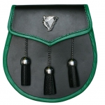 Metal Lady & Harp badge on the flap Edges bound in green leather Opens