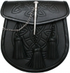 black smooth leather embossed with a Celtic pattern. It has 3 leather tassels and a metal loop and pin closure on the flap,