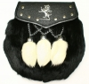 Leather flap with bound edge and studs with metal Lion Rampant Opens and closes with a stud  Black Rabbit fur front with 3 white rabbit tassles on V chains